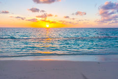 Beautiful sunset with sky over calm sea  in tropical Maldives is. Land Stock Photo