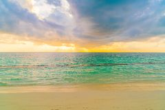 Beautiful sunset with sky over calm sea  in tropical Maldives is. Land Royalty Free Stock Photo