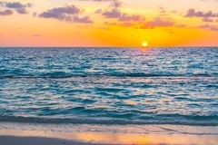 Beautiful sunset with sky over calm sea  in tropical Maldives is. Land Royalty Free Stock Photos