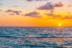 Beautiful sunset with sky over calm sea  in tropical Maldives is. Land Stock Images