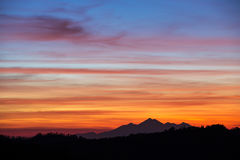 Beautiful sunset sky over the mountains in Bali. Indonesia Royalty Free Stock Image