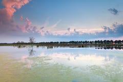 Beautiful sunset sky reflected in lake Stock Image