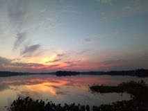 Beautiful sunset sky with reflexion over the lake. Sunset over the lake with reflexion Royalty Free Stock Images