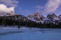 Beautiful sunset in snowy alpine valley. Misurina lake and Cadini mountains group, Italy Royalty Free Stock Image