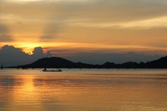 Beautiful sunset in songkhla lake. Beautiful color landscape on sunset background in songkhla lake thailand stock photo
