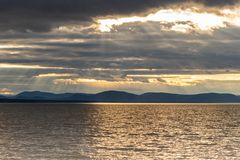 Generic Sunset over the st-lawrence river in Quebec, Canada. Beautiful sunset on the south shore of the fleuve st-laurent. Sun rays reflecting on the water stock images