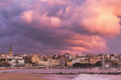 Beautiful sunset in Spain with big clouds, Costa Brava, town Pal Stock Image