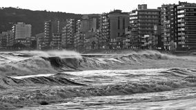 Beautiful sunset in Spain with big waves in black and white colo Royalty Free Stock Image