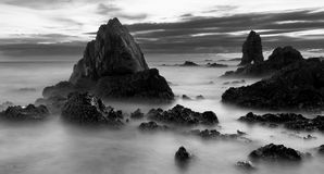 Beautiful sunset at the stone beach in black and white. A beautiful sunset at the stone beach in black and white, Thailand Royalty Free Stock Images