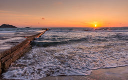 Beautiful sunset with stone pier in northern Corfu, Greece. royalty free stock images