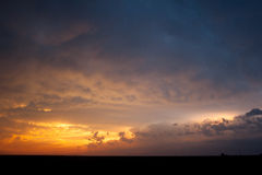 Beautiful Sunset After the Storm. A beautifully brilliant sunset lights up the sky after a severe storm Stock Image