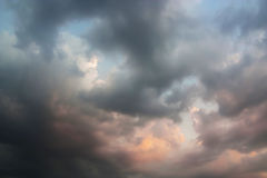 Beautiful Sunset with Storm Cloud and Blue Sky. Royalty Free Stock Images