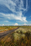 Beautiful sunset. Summer landscape with blue sky, clouds, road Royalty Free Stock Image
