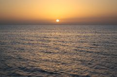 The sun sets in the waters of the sea of Azov in the South of Russia. Beautiful sunset: the sun sets in the waters of the Azov sea in the South of Russia Stock Photography
