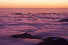 Beautiful sunset or sunrise above the clouds. Romania Stock Photos
