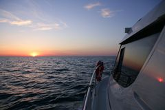 Beautiful sunset sunrise over blue sea  in a yacht Royalty Free Stock Image