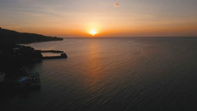 Beautiful sunset or sunrise over sea, aerial view. Philippines. Marine tropical sunset over the sea. Aerial view: Sunset over the sea in the background orange stock video footage