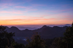 Beautiful sunset on top of the mountain at Doi Ang Khang, Thaila Stock Photo