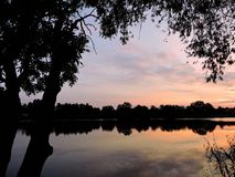 Beautiful sunset, trees  and river, Lithuania Royalty Free Stock Photography