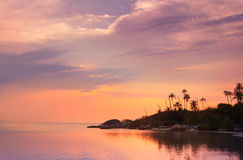 Beautiful sunset on a tropical beach in Thailand. Koh Phangan Stock Photos
