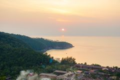 Beautiful sunset on tropical island Koh Phangan in Thailand. Blue sea water in island royalty free stock images
