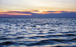 Beautiful sunset on a turbulent sea Royalty Free Stock Photography
