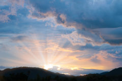 Beautiful sunset twilight time behind the mountain. Stock Image
