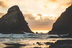 Beautiful sunset between two sea rock stacks Royalty Free Stock Images