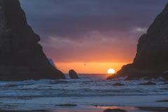 Beautiful sunset between two sea rock stacks Royalty Free Stock Image