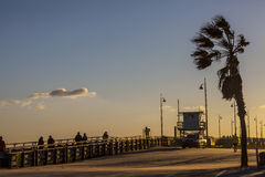 Beautiful Sunset at Venice beach in Los Angeles, California. A beach, lifeguard tower and a pier during a sunset Royalty Free Stock Image