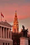 Town Hall Tower (The Rathaus) and the Parliament Building. Gorgeous sunset - landmark attraction in Vienna, Austria Royalty Free Stock Photos