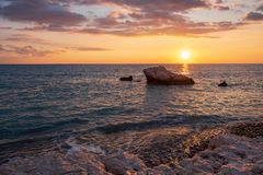 Beautiful sunset view of the beach around Petra tou Romiou, also known as Aphrodite`s birthplace, in Paphos, Cyprus royalty free stock images