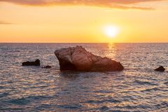 Beautiful sunset view of the beach around Petra tou Romiou, also known as Aphrodite`s birthplace, in Paphos, Cyprus royalty free stock photo