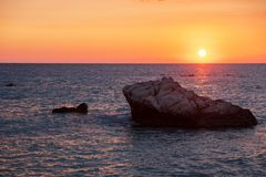 Beautiful sunset view of the beach around Petra tou Romiou, also known as Aphrodite`s birthplace, in Paphos, Cyprus stock images