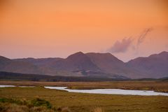 Beautiful sunset view of Connemara. Scenic Irish countryside landscape with magnificent mountains on the horizon, County Galway, I. Beautiful sunset view of stock photo
