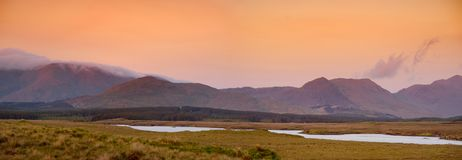 Beautiful sunset view of Connemara. Scenic Irish countryside landscape with magnificent mountains on the horizon, County Galway, I. Beautiful sunset view of royalty free stock photography