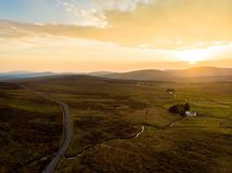 Beautiful sunset view of Connemara. Scenic Irish countryside landscape with magnificent mountains on the horizon, County Galway, I. Beautiful sunset view of stock image