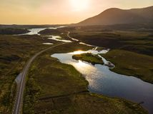 Beautiful sunset view of Connemara. Scenic Irish countryside landscape with magnificent mountains on the horizon, County Galway, I. Beautiful sunset view of stock photography