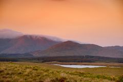 Beautiful sunset view of Connemara. Scenic Irish countryside landscape with magnificent mountains on the horizon, County Galway, I. Beautiful sunset view of royalty free stock images