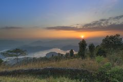 Beautiful sunset view from hilltop begnas lake stock image