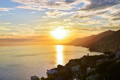 Beautiful sunset view over Adriatic sea in Italy. Stunning sunset over the sea seen from Camogli coast, Italy royalty free stock photography