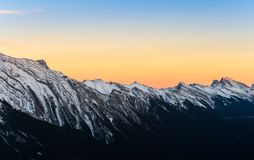 Beautiful sunset view of snow capped Rocky mountains at Banff Na royalty free stock photos
