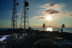 Beautiful sunset view of some buildings and antenna radio in San Andres Island Colombia and Caribbean Sea South America.  Stock Photos