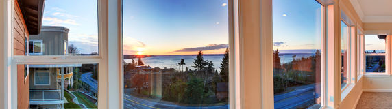 Beautiful sunset view through the windows. Panoramic picture Stock Photography