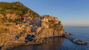 Beautiful sunset on the village of Manarola, Cinque Terre, Liguria, Italy stock images