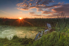Beautiful  sunset in the village river Stock Photo
