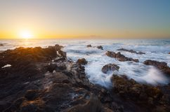 Sunset on volcanic rocks in Saint-Leu,Reunion Island. Beautiful sunset on volcanic rocks in Saint-Leu,Reunion Island Royalty Free Stock Photo