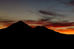 Beautiful sunset and volcano Stock Images