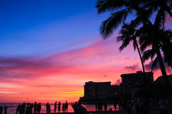 Beautiful sunset on Waikiki Beach Stock Photos