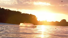 Beautiful Sunset Wakeboarding FHD stock video footage